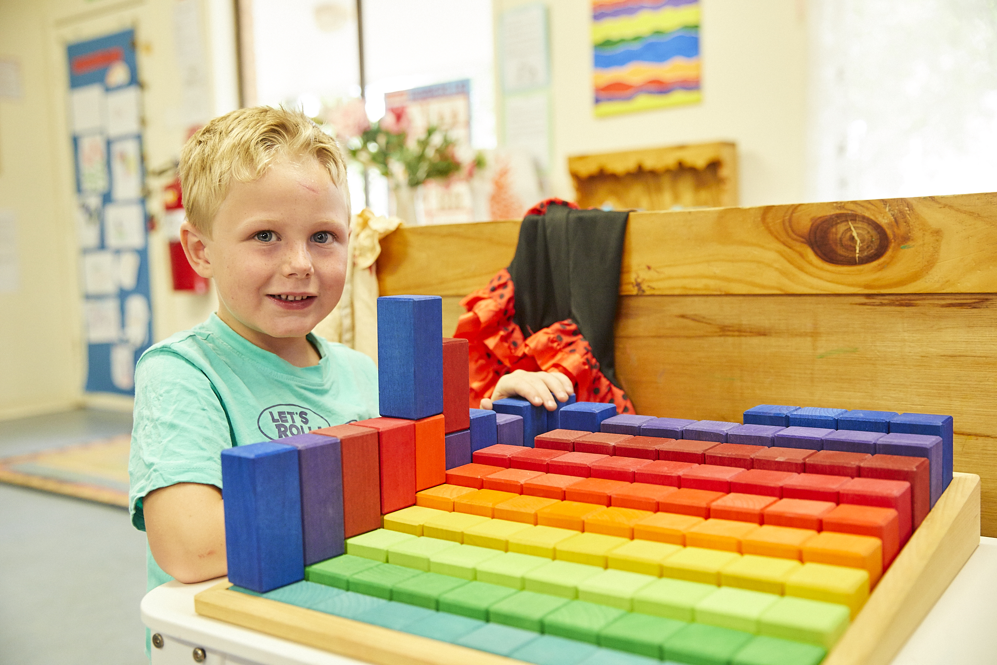 Young child playing with toys in child care classroom at Premier Early Learning Moruya